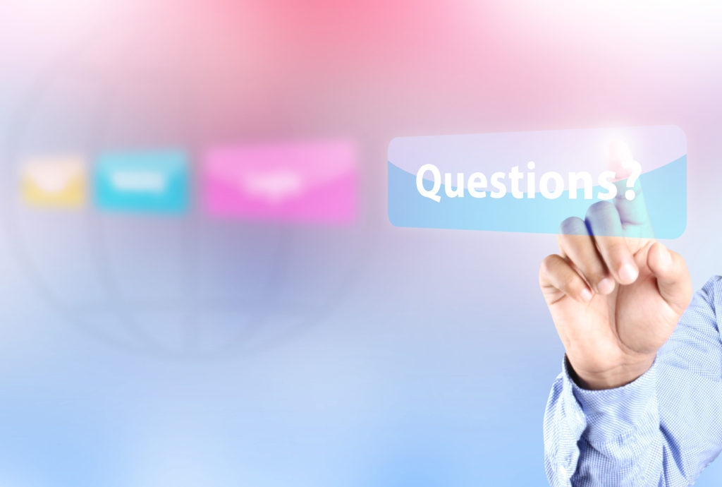 "Frequently Asked Questions - Hand pointing to the word ""Questions?"""